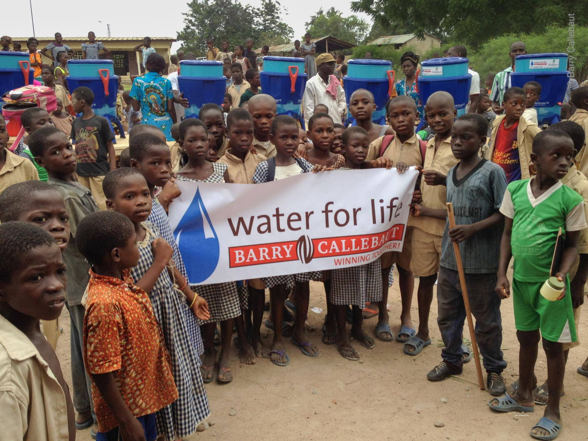 Distributing water filters in remote cocoa areas of West Africa