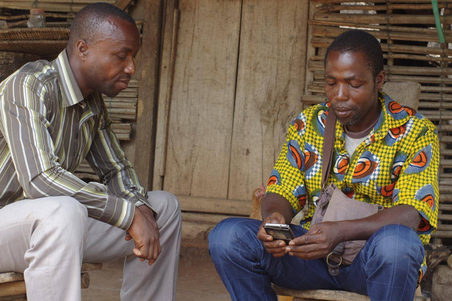 Cocoa farmers with smartphones