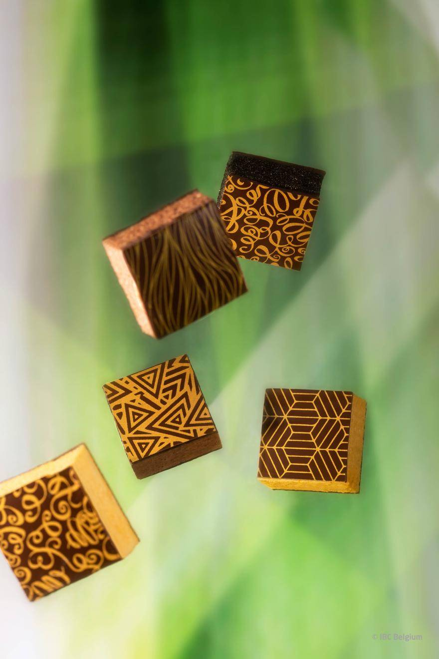 Chocolate pralines with gold design