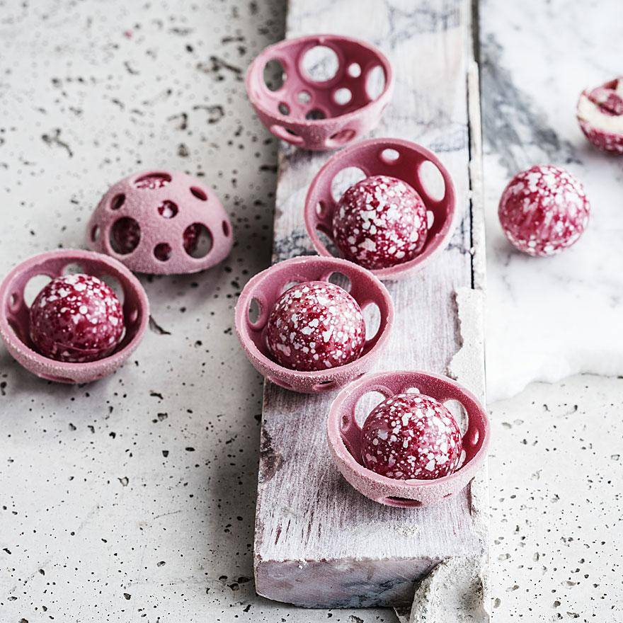ruby chocolate bonbons on plate