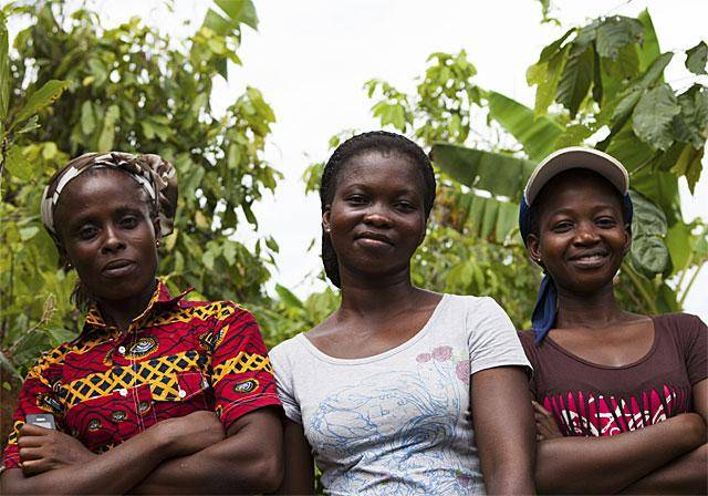 Three women farmers standing side-by-side