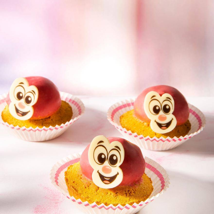 Cupcakes with happy face chocolate decorations