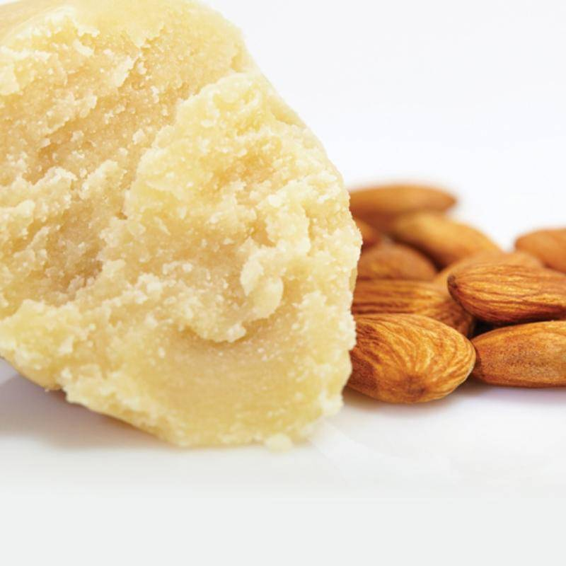 almond paste and almonds on white background