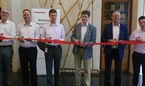 Cutting the ribbon at new chocolate manufacturing facility in Singapore