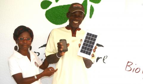 Zallé Alimissi Salame proud of his new mobile phone and solar charger.