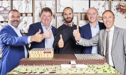 Thumbs Up for Barry Callebaut's new Global Distribution Center - from left to right: Stefan Walgraeve, Filip Anthuenis, Davide Comaschi, Massimo Garavaglia, Joost Uwents