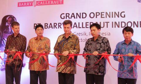 Cutting the ribbon at opening ceremony of new chocolate factory in Indonesia