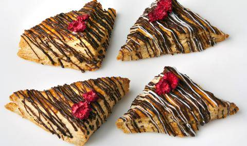 Four scones drizzled with dark and white chocolate