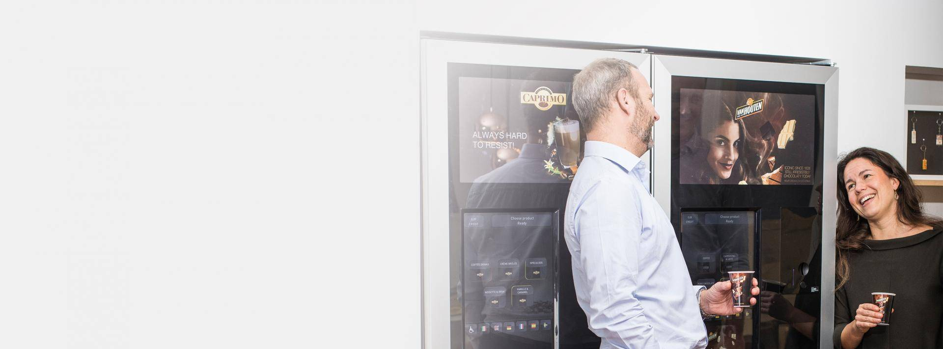Man at vending machine with woman