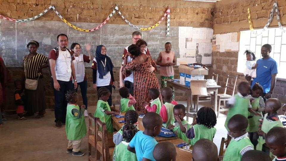 Barry Callebaut Water for Life champions during Cameroon cocoa study tour - distributing school supplies at primary school