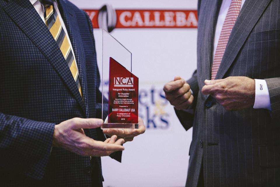 Jerry Hagedorn, EVP Business Development accepting the award from John Downs of the NCA