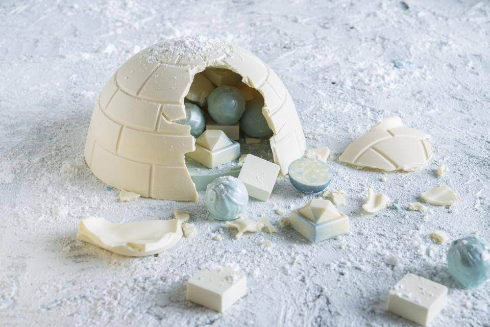 White chocolate, blue colored chocolate pralines, white igloo
