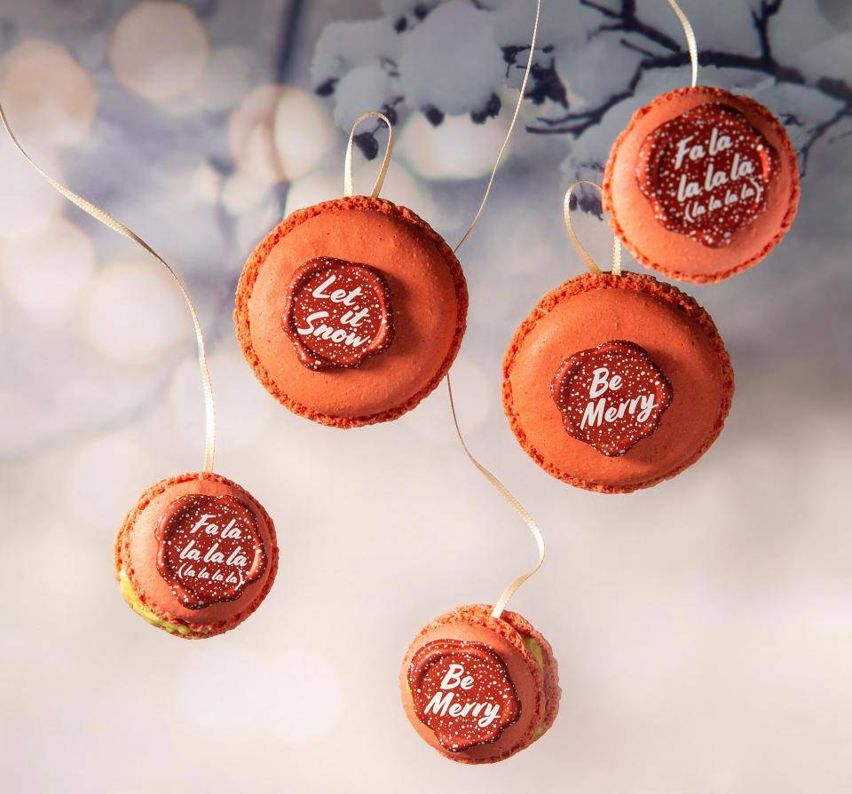 Red macarons, chocolate seals, Christmas slogans white snowflakes