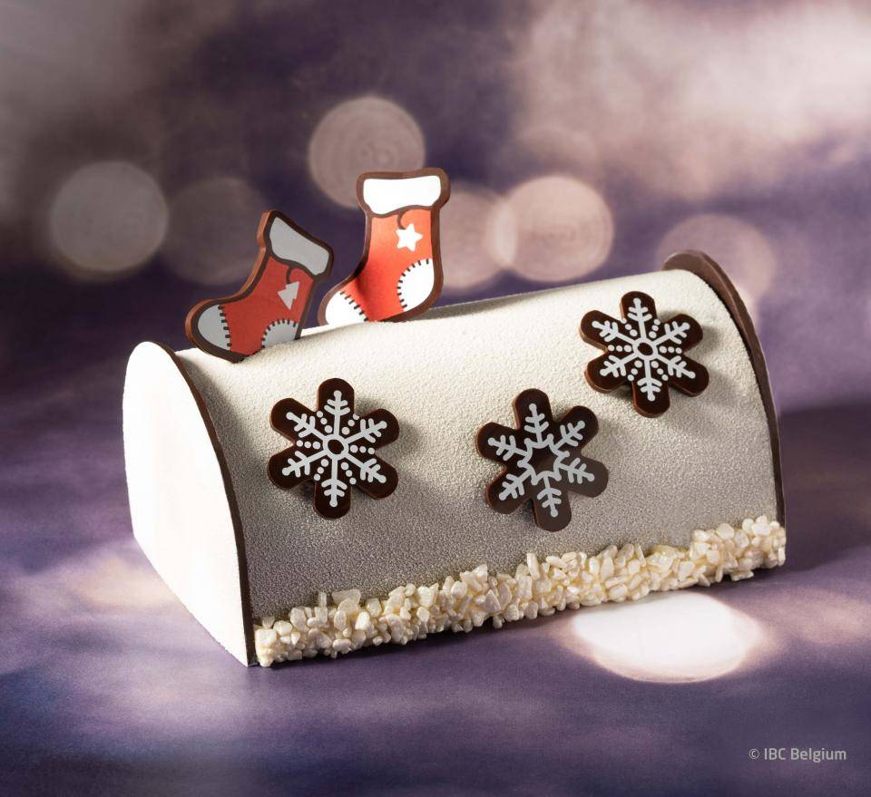 White chocolate, dark embouts, Christmas shapes stocking, silvery-white marzipan crunshes