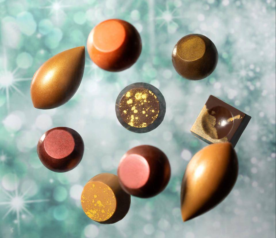 sparkling and shimmering colors, chocolate pralines, golden accents