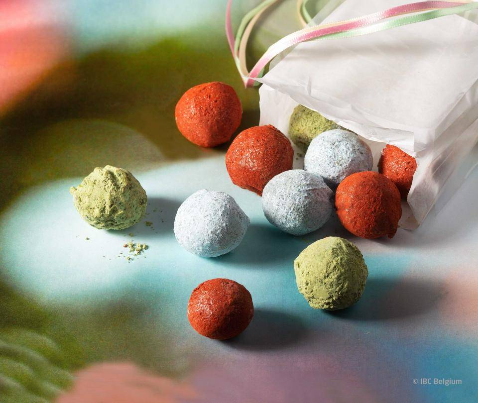 Chocolate truffles, green, red, silver and white truffle powder