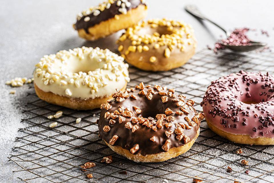 Chocolate-covered donuts with metallic chocolate sprinkles
