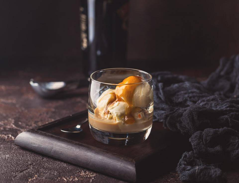 glass of ice cream topped with liquor