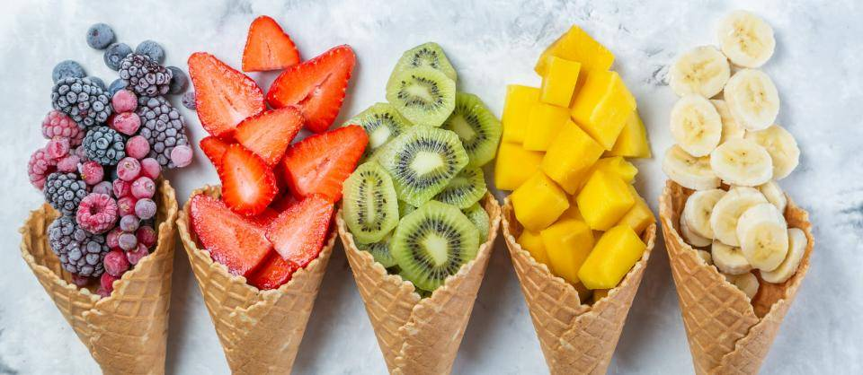 ice cream cones filled with fruit