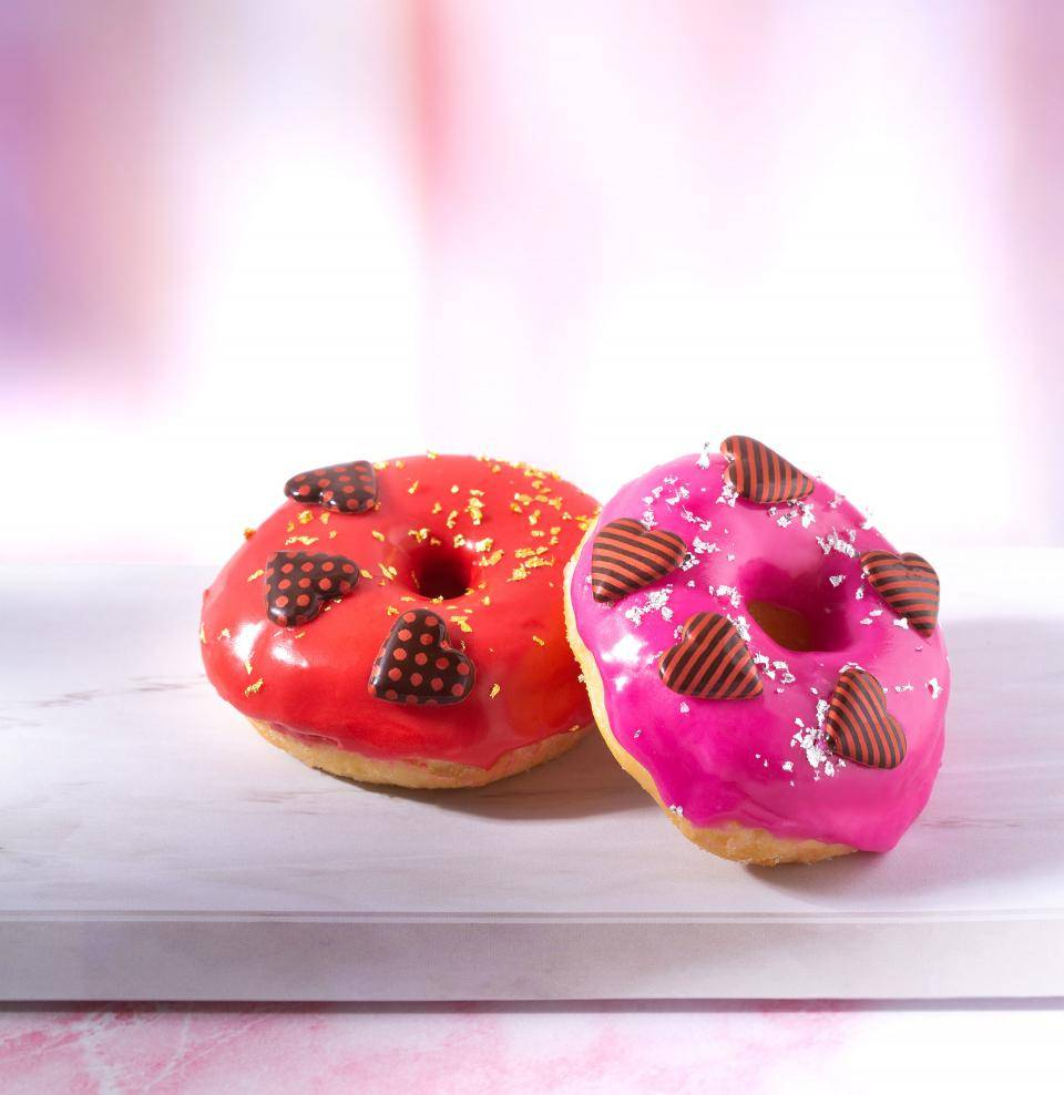 Valentine's Day donuts with pink and red glaze and chocolate hearts