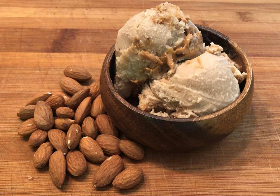 bowl of almond ice cream on cutting board