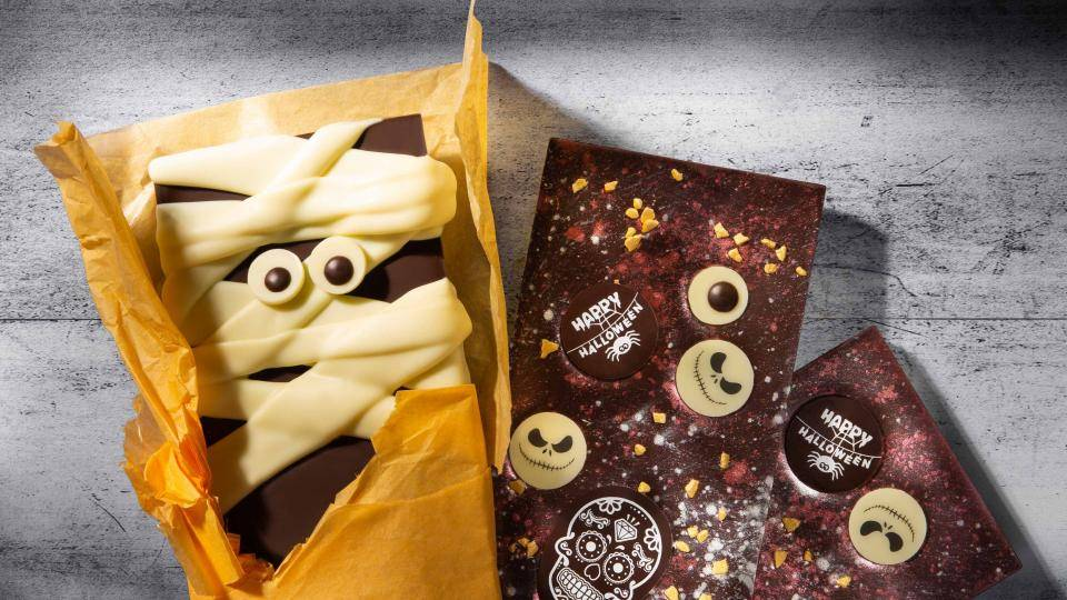 Chocolate bars with eyes and Halloween decorations