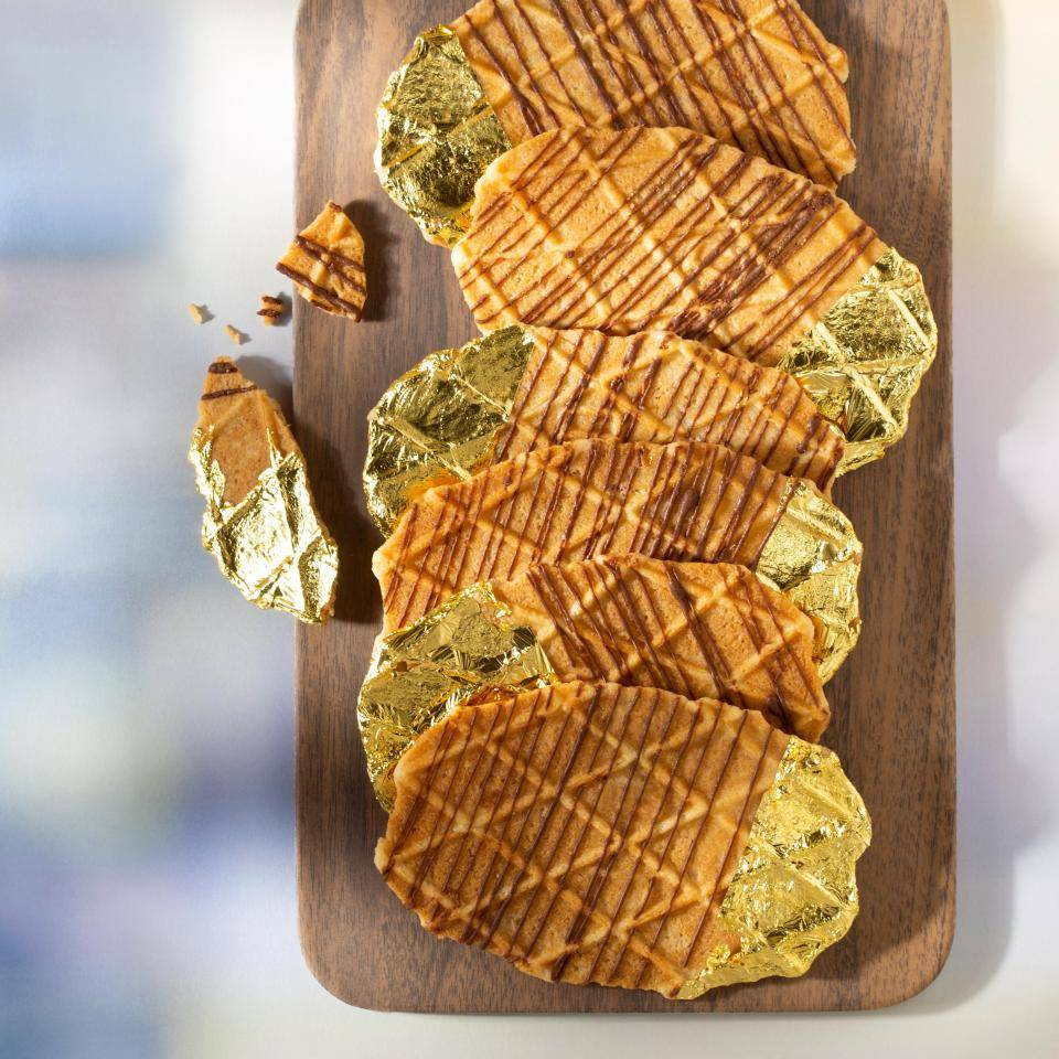 Thin waffels with an edible gold decoration