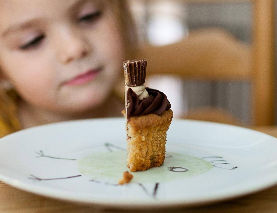 Little girl eating organic chocolate cupcake