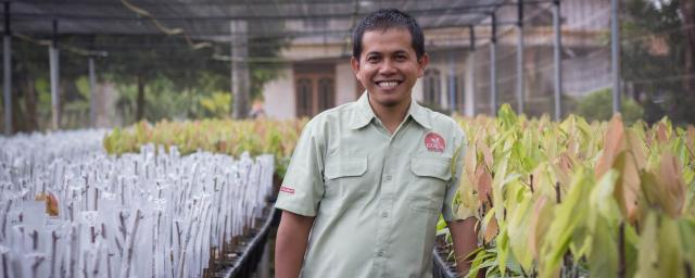 Barry Callebaut employee Sarono at cocoa nursery
