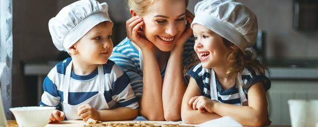 Happy mom and kids baking together