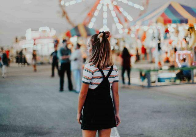 Teenager at retro fairground. Photo by Hannah Busing on Unsplash.